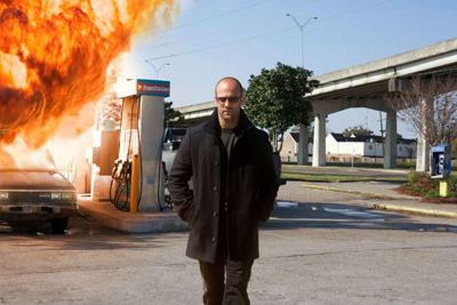 "Patti Perret/CBS Films photo, Jason Statham does the Charles Bronson thing in ""The Mechanic."" Photo: AP / © 2010 CBS FILM INC."