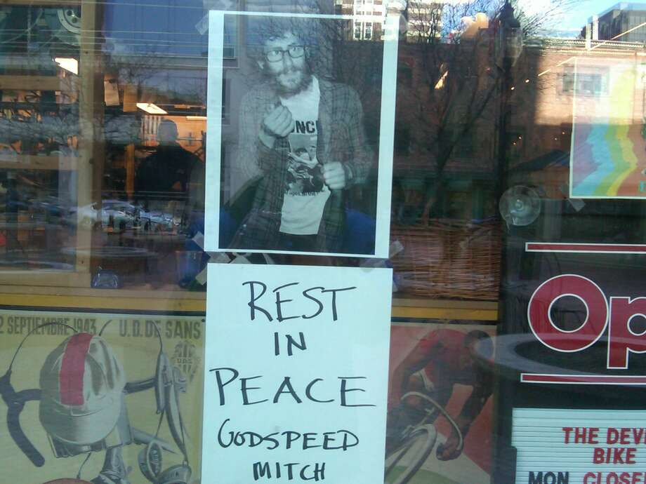 Mitchell Dubey, of 29 Bassett St., was fatally shot late Thursday. This sign is posted at The Devil's Gear Bike Shop in New Haven, where he worked.  Photo by William Kaempffer