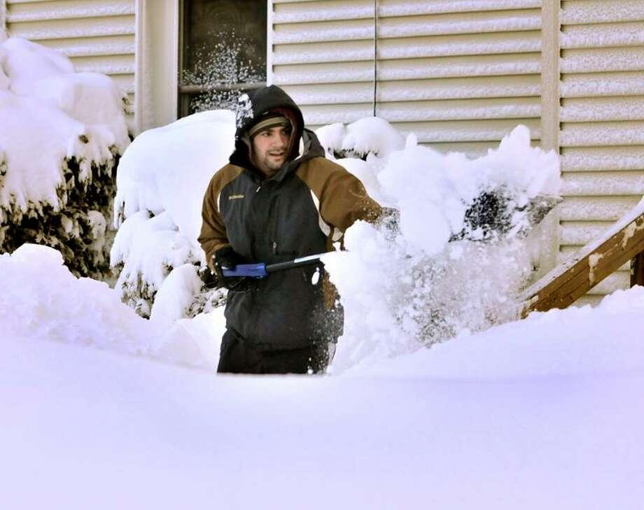 Dominic Amaturo shovels his wall on Fairfield Street in New Haven.   Melanie Stengel/Register
