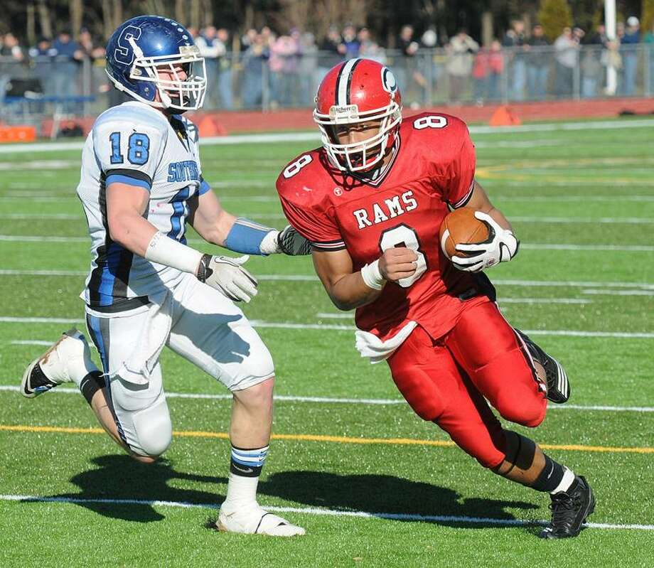 Cheshire-- Cheshire's Sebastian Little blasts into the end-zone as Southington's Matthew O'Connor defends during the first quarter. Peter Casolino/New Haven Register11/24/11