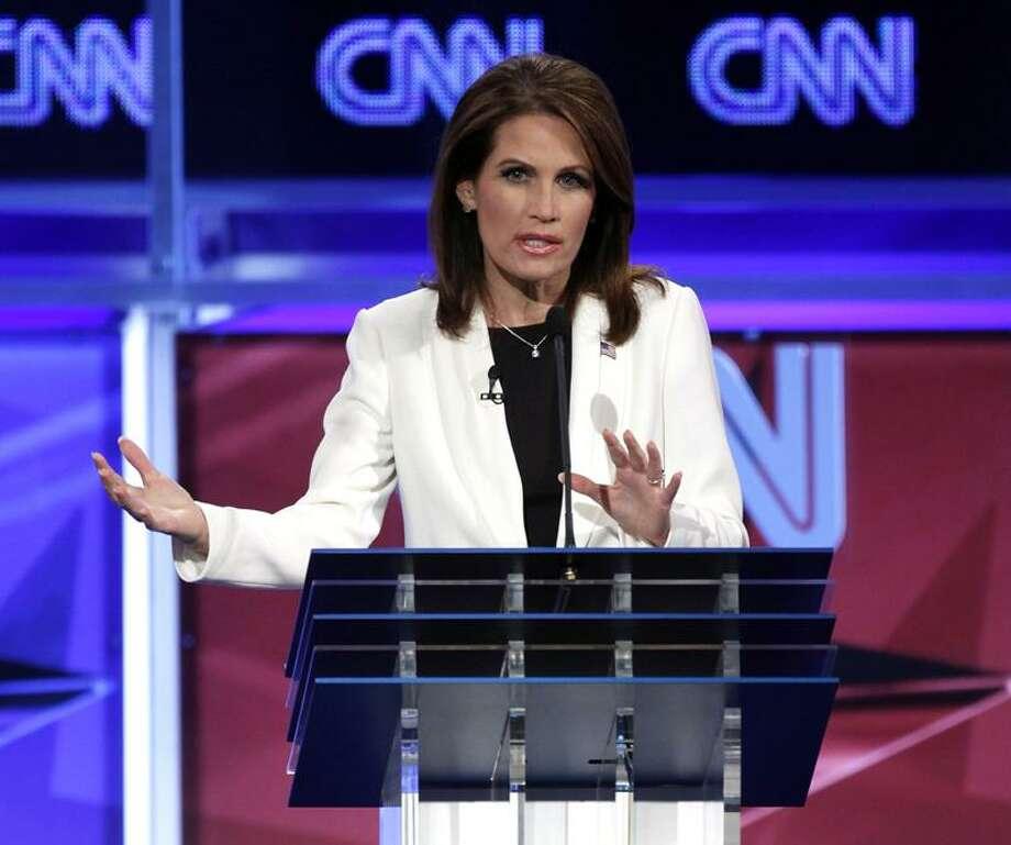 Republican presidential candidate Rep. Michele Bachmann, R-Minn., speaks at a Republican presidential debate in Washington, Tuesday, Nov. 22, 2011. (AP Photo/Evan Vucci) Photo: AP / AP2011