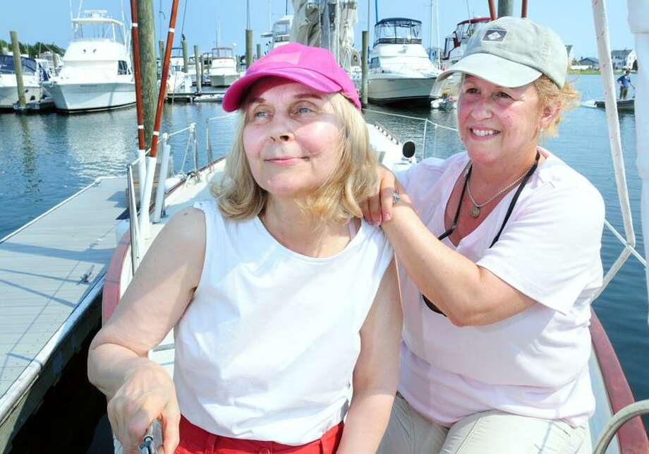 Carline Lutyaski (left) and Joy Sherman (right) are photographed on Sherman's boat, Hado. at Pilots Point Marina in Westbrook on 7/19/2011.Photo by Arnold Gold/New Haven Register     AG0419B
