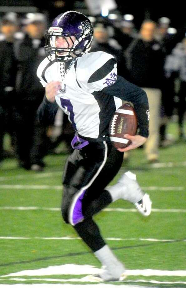 Joe DeLucia of North Branford runs for a touchdown against Hyde in the first half of the Harvest Bowl at Veterans Stadium in West Haven on 11/23/2011. Photo by Arnold Gold/New Haven Register   AG0431A