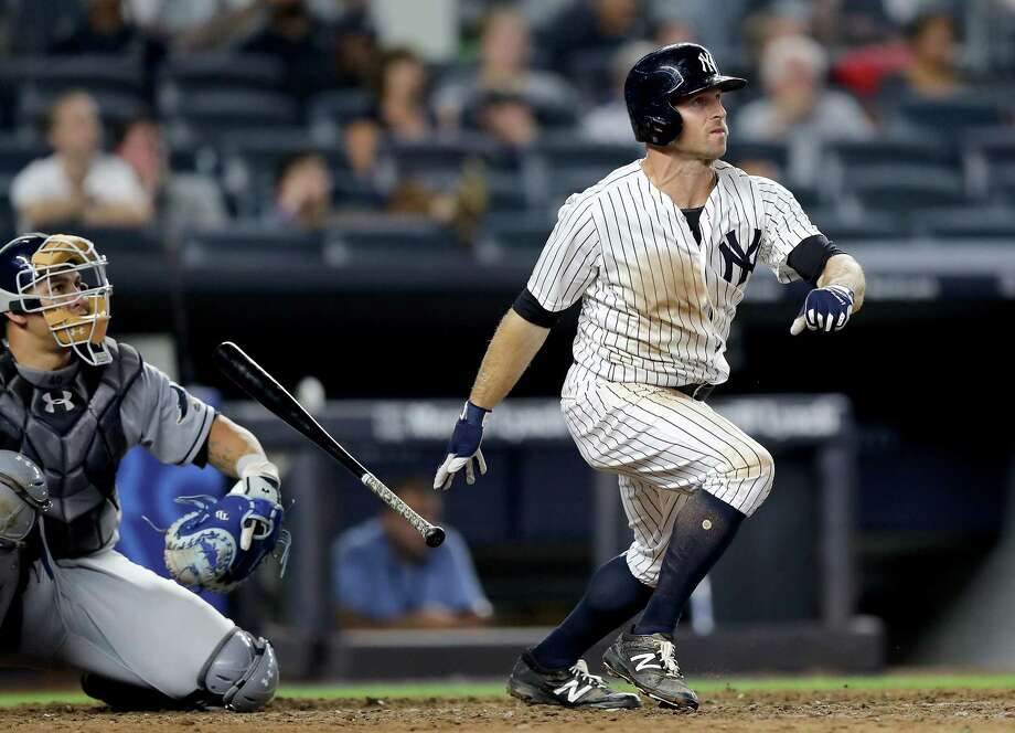 NEW YORK, NY - JULY 27:  Brett Gardner #11 of the New York Yankees hits a solo home run in the 11th inning as Wilson Ramos #40 of the Tampa Bay Rays defends on July 27, 2017 at Yankee Stadium in the Bronx borough of New York City.  (Photo by Elsa/Getty Images) ORG XMIT: 700011779 Photo: Elsa / 2017 Getty Images