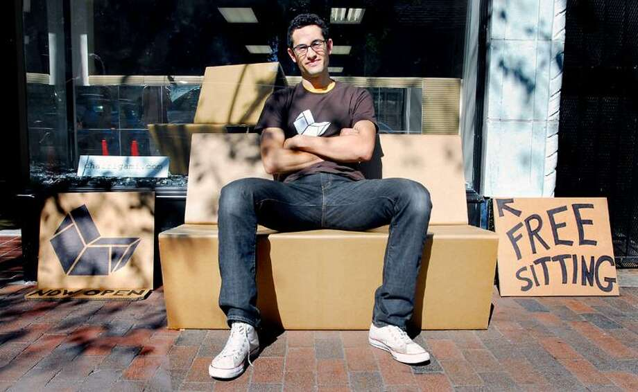 Arnold Gold/Register: Zachary Rotholz likes to sit down on the job. It gives visitors to the Yale engineer's Chairigami cardboard furniture store a chance to see how sturdy and functional his creations are.