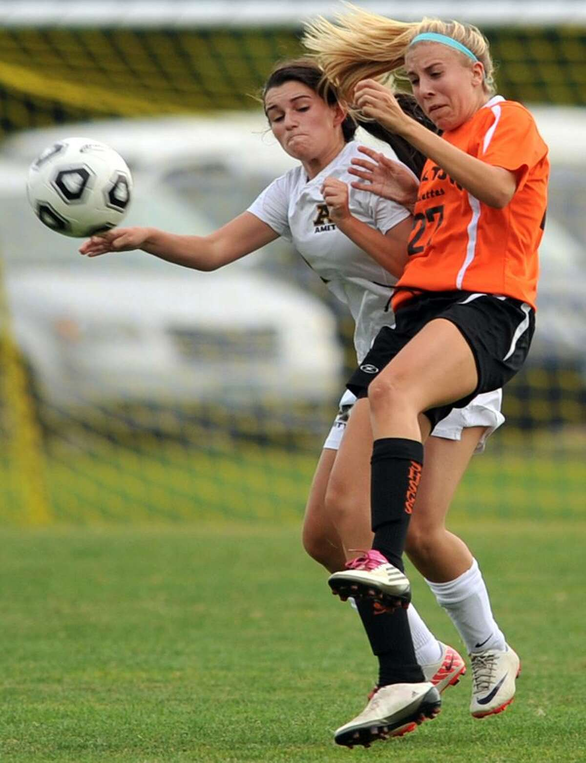 Amity's Samantha Woodwoord, left, and Brittany Innamorato-Brannen of Shelton battle for a header during second-half soccer action of a 1-1 tie. Photo by Peter Hvizdak / Register