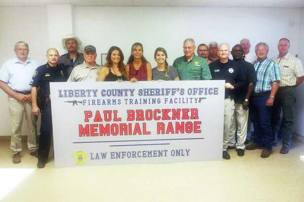 Brockner's wife, Jan, and daughters, Abby Brockner and Drinda Pena, center, join Sheriff Bobby Rader and others at the dedication of the firearms range that now bears his name.