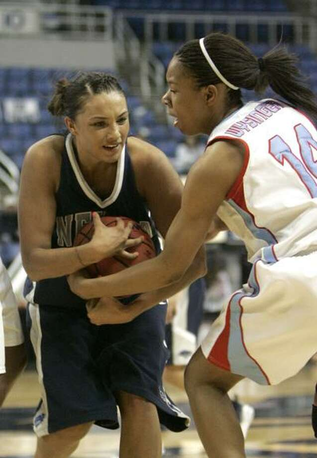 Nevada's Tahnee Robinson, left, and Tarkeisha Wysinger battle for the ball during the second half of an NCAA college basketball game  at the Western Athletic Conference tournament in Reno, Nev., Friday, March 12, 2010. Louisiana Tech defeated Nevada 80-77. (AP Photo/Rich Pedroncelli) Photo: AP / AP