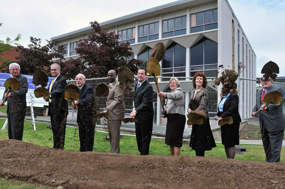 Gov. Dannel P. Malloy, center, and other dignitaries throw dirt during a ground-breaking ceremony for the new Southern Connecticut State University School of Business. (Photo by Peter Casolino/New Haven Register)