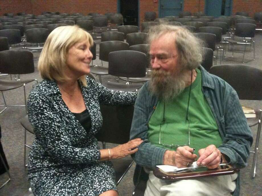 Former Connecticut Poetry Society president Christine Beck shares a laugh with Donald Hall, former U.S. poet laureate, after a program at Thornton Wilder Hall of Miller Library Friday night. Ann DeMatteo/Register