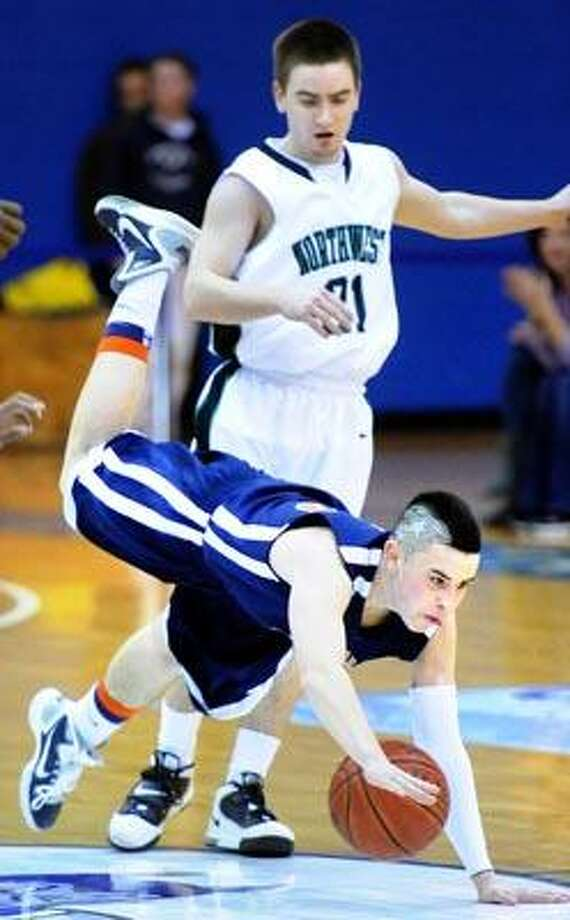 Kevin Ruys (bottom) of Lyman Hall is fouled by Tyler Huffman (top) of Northwest Catholic in the first half of their Class L Semifinal game at Central Connecticut State University on 3/16/2011.Photo by Arnold Gold/New Haven Register     AG0405E