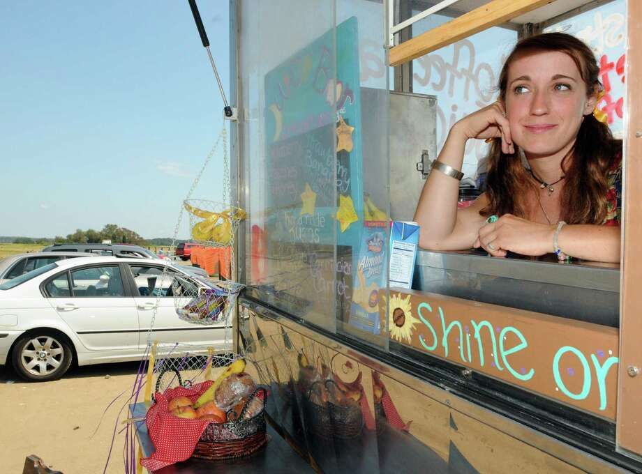 Lizzie McCandless, owner of  Cafe Zephyr, a mobile coffee and juice bar at the Town of Guilford Marina. (Peter Hvizdak / New Haven Register)