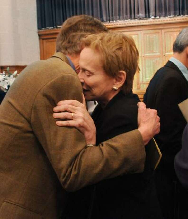New Haven- Jerry  Mashaw, Sterling Professor of Law, Yale Law School (L) hugs  Sheila Wellington after the the Remembrance and Celebration of her husband,  Harry Wellington . The celebration was held at the Yale Law School. Wellington, who died at age 84 in August of this year, was former Dean of the Yale Law School and of New York Law School.    Melanie Stengel/Register