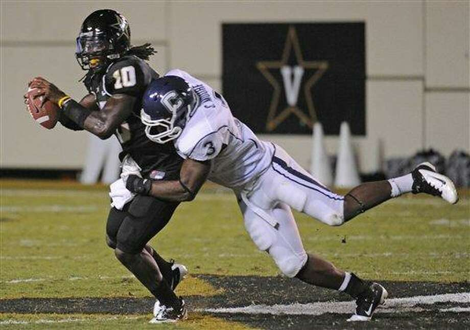 Connecticut linebacker Sio Moore (3) sacks Vanderbilt quarterback Larry Smith in the second quarter of an NCAA college football game on Saturday, Sept. 10, 2011, in Nashville, Tenn. (AP Photo/John Russell) Photo: AP / FR61761 AP