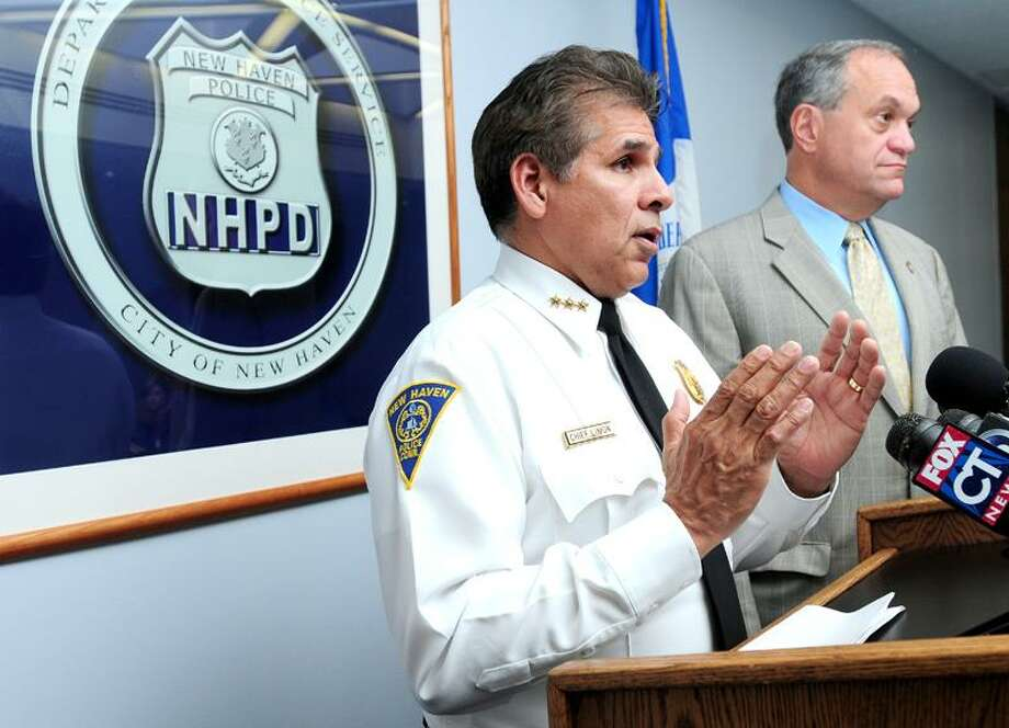 New Haven police Chief Frank Limon, left, and Mayor John DeStefano Jr. talk during a press conference Tuesday about the number of guns seized so far this year by the police department. Arnold Gold/Register