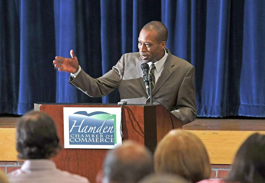 Hamden--Mayor Scott D. Jackson delivers his state of the town address to the Hamden Camber of Commerce and members of the public at the Miller Library.  Photo by Peter Casolino/New Haven Register