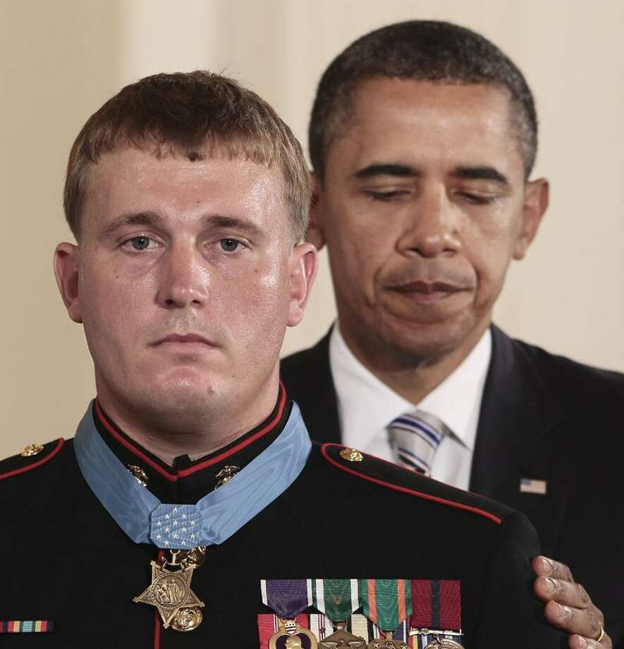 President Barack Obama awards the Medal of Honor to former Marine Cpl. Dakota Meyer, 23, from Greensburg, Ky., Thursday during a ceremony in the East Room of the White House in Washington, D.C. Meyer, now a sergeant, was in Afghanistan's Kunar province in Sept. 2009 when he repeatedly ran through enemy fire to recover the bodies of fellow American troops. He is the first living Marine to be awarded the Medal of Honor for actions in Iraq or Afghanistan. Associated Press Photo: AP / 2011 AP