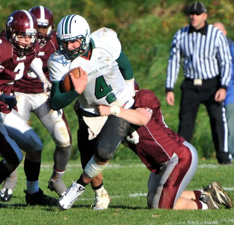 T.J. Linta of Hamden Hall gets tackled behind the line of scrimmage by Gordon Driscoll of Hopkins during the overtime period of football action Saturday 11/12/11 at Hopkins. Photo by Peter Hvizdak / New Haven Register November  12, 2011     ph2406               Connecticut