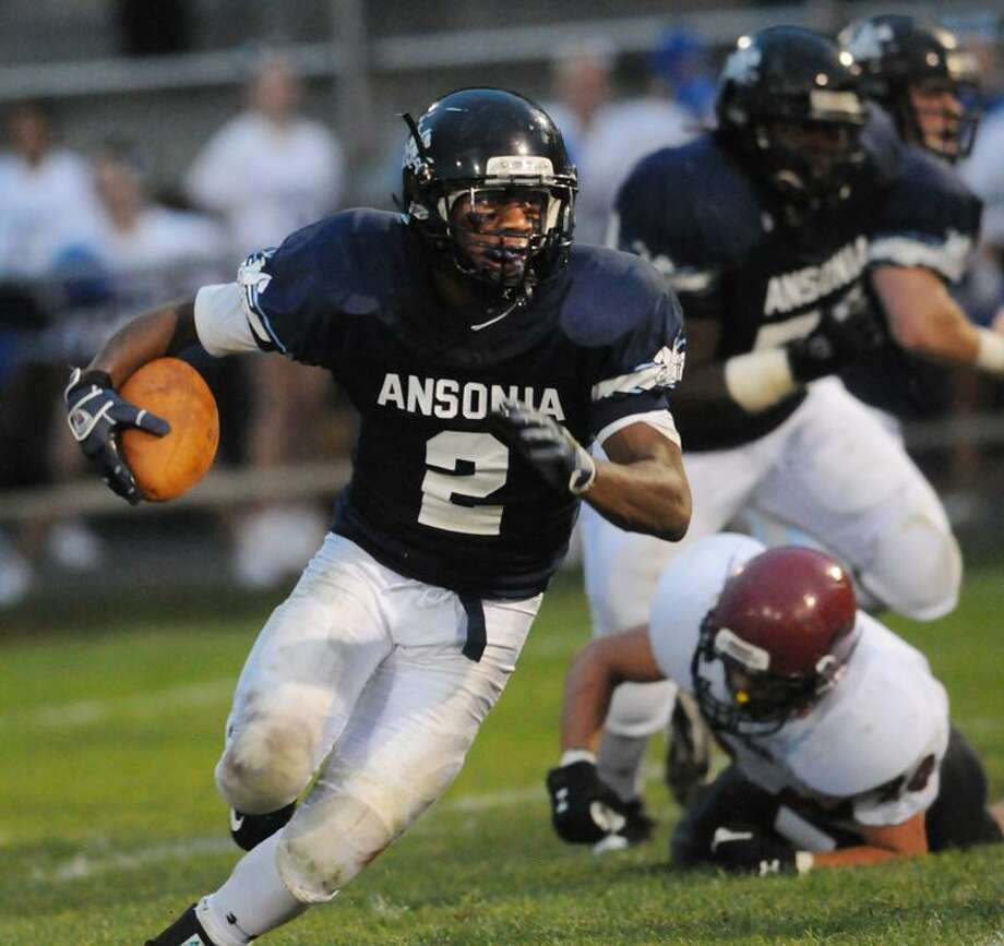 SPORTS-Ansonia's Arkeel Newsome scored six touchdowns against Torrington. Melanie Stengel/Register