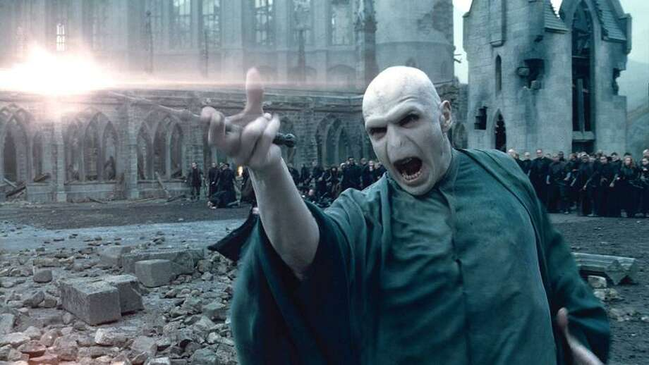 """In this film publicity image released by Warner Bros. Pictures, Ralph Fiennes portrays Lord Voldemort in a scene from """"Harry Potter and the Deathly Hallows: Part 2."""" (AP Photo/Warner Bros. Pictures) Photo: AP / (C) 2011 WARNER BROS. ENTERTAINMENT INC. HARRY POTTER PUBLISHING RIGHTS (C) J.K.R. HARRY POTTER CHARACTERS, NAMES AND RELATED IN"""