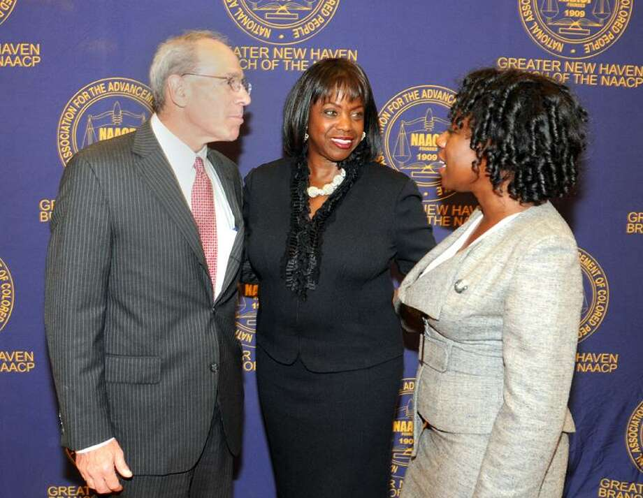 Carolyn Hebsgaard, center, executive director of the Lawyers Collaborative for Justice and winner of the Greater New Haven Branch NAACP's Trailblazer award, speaks with New Haven lawyers Mark G. Sklarz, left, and Ndidi Moses during the first Constance Baker Motley Cocktail Reception Thursday at the Yale University Law School. Peter Hvizdak/Register