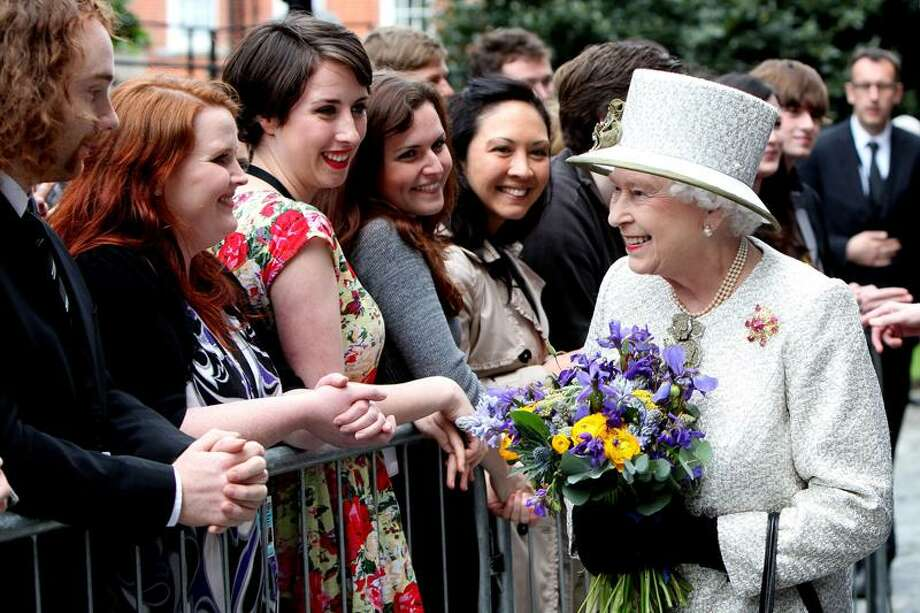 Britain's Queen Elizabeth II meets students and staff at Trinity College in Dublin Tuesday. The Queen set foot on Irish soil at the start of a historic state visit which will herald a new era in relations between Britain and the Republic. Politicians on both side of the Irish Sea have described the four-day event as momentous. Associated Press Photo: AP / POOL, MAXWELL'S