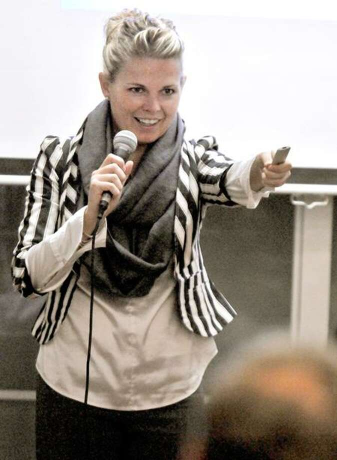 """Candace Klein, founder of Bad Girl Ventures and an attorney that advises start-ups, gives the keynote speech, """"The Secrets of the 3-minute pitch,"""" to would-be entrepreneurs during the inaugural Startup Weekend New Haven event at The Grove on Orange Street in New Haven Saturday. Peter Hvizdak/Register"""