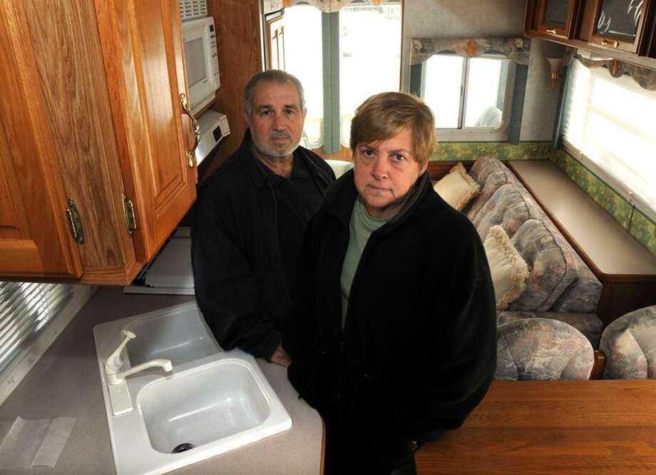 Marion and Louis Nero of Cheshire visit their RV being kept in Westbrook. They are not happy that the state is suddenly enforcing camping limits at the state shoreline parks. Mara Lavitt/New Haven