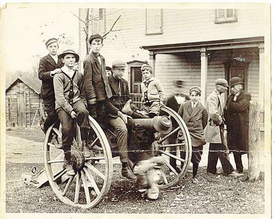 Photo Courtesy LOUIS BEST Boys sit on a cannon in Durhamville. The hamlet is celebrating its bicentennial on Saturday and Sunday.