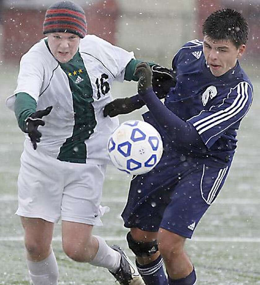 """Dispatch Staff Photo by JOHN HAEGER <a href=""""http://twitter.com/oneidaphoto"""">twitter.com/oneidaphoto</a> Hamilton's Charlie Jerome (16) and Cherry Valley Springfield Andrew Spencer (6) vie for the loose ball in the first half of the NYSPHSAA soccer match in Morrisville on Friday, Nov. 11, 2011."""