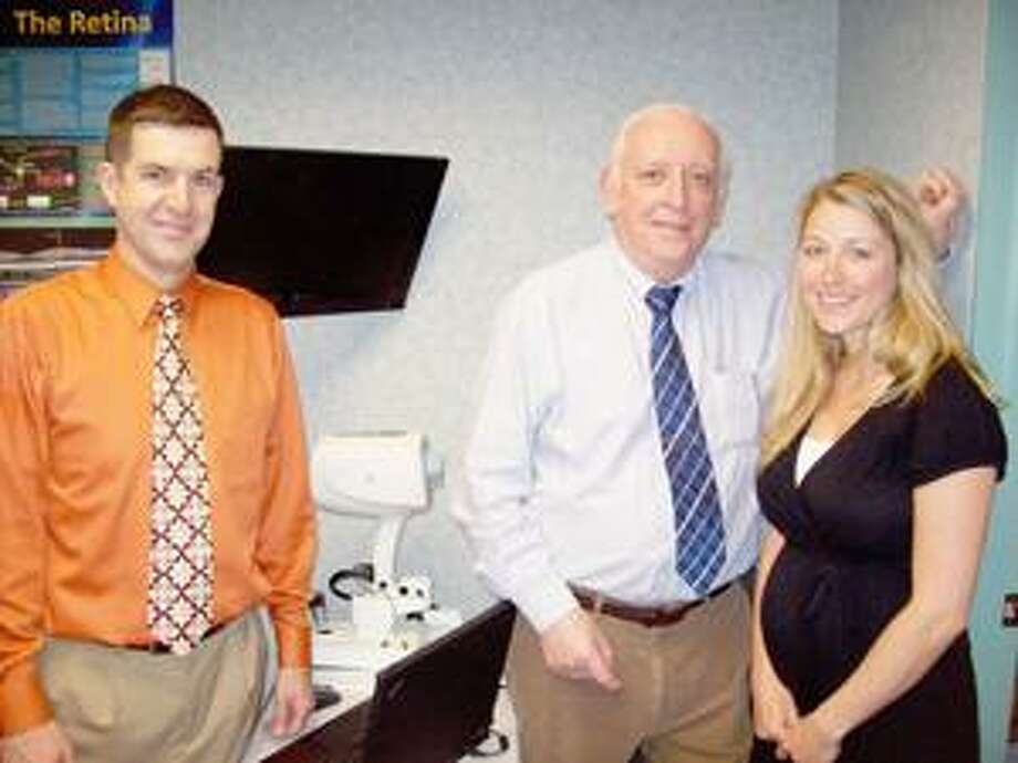 Photo Special to the Dispatch by MIKE JAQUAYS Dr. John Costello Sr., center, is joined at Costello Sr.-Allen Eye Associates by Dr. Matthew Allen, left, and Dr. Jennifer Cummings in providing quality and convenient eye care. Their office is at 578 Seneca St. in Oneida; call them at 363-4942.
