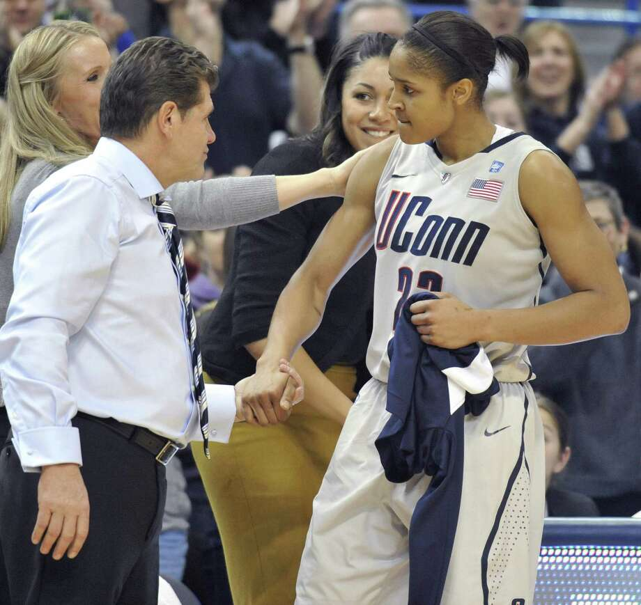 Head coach Geno Auriemma greets Maya Moore off the court in the second half of an NCAA basketball game in Hartford, Conn., Tuesday, Dec. 21, 2010. Heading into the game, Connecticut won 93-62 to to set the NCAA record for consecutive wins by a college basketball team. (AP Photo/Jessica Hill) Photo: ASSOCIATED PRESS / AP2010