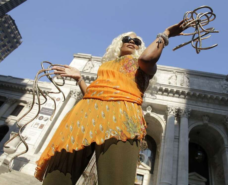 "Chris ""The Dutchess"" Walton shows off her record-breaking fingernails in New York Wednesday. Walton holds the world's record for the longest fingernails on a pair of female hands, according to the new Guinness World Records 2012 book. Associated Press"
