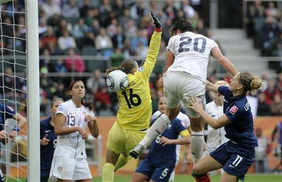 United States' Abby Wambach, center, scores her side's 2nd goal during the semifinal match between France and the United States at the Women's Soccer World Cup in Moenchengladbach, Germany, Wednesday, July 13, 2011. (AP Photo/Martin Meissner) Photo: ASSOCIATED PRESS / AP2011