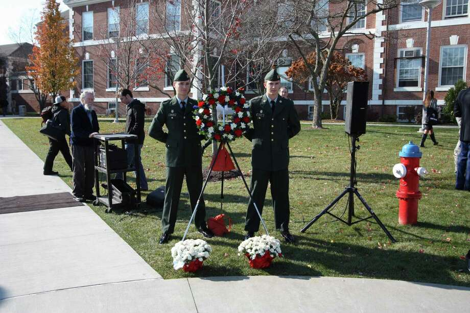 UNH ROTC cadets guard the commemorative wreath that was positioned next to the podium during the ceremony   Photo by Noel Sardalla, University of New Haven.