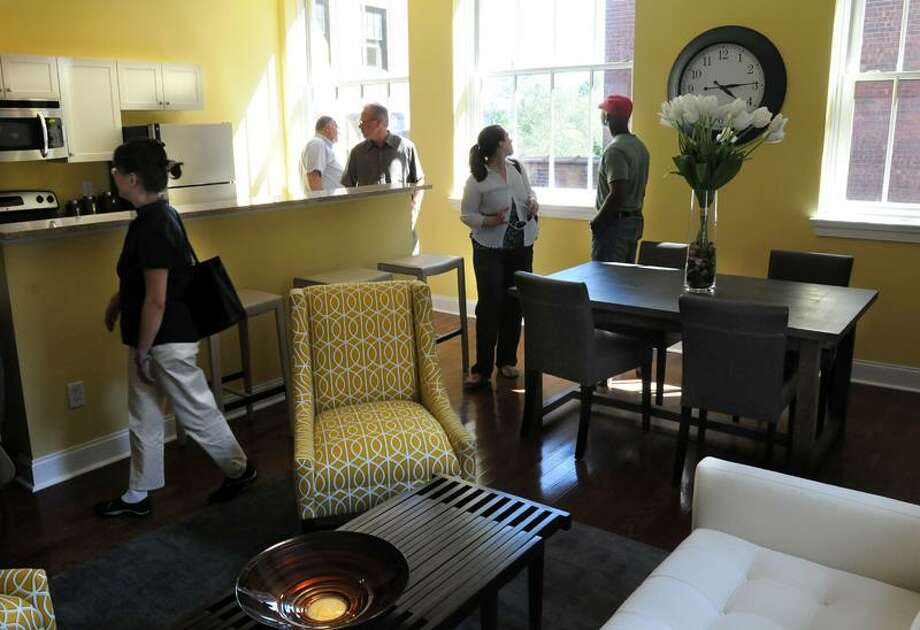 Visitors tour the newly renovated historic buildings at 40-44 Crown St., New Haven, Wednesday. Mara Lavitt/Register