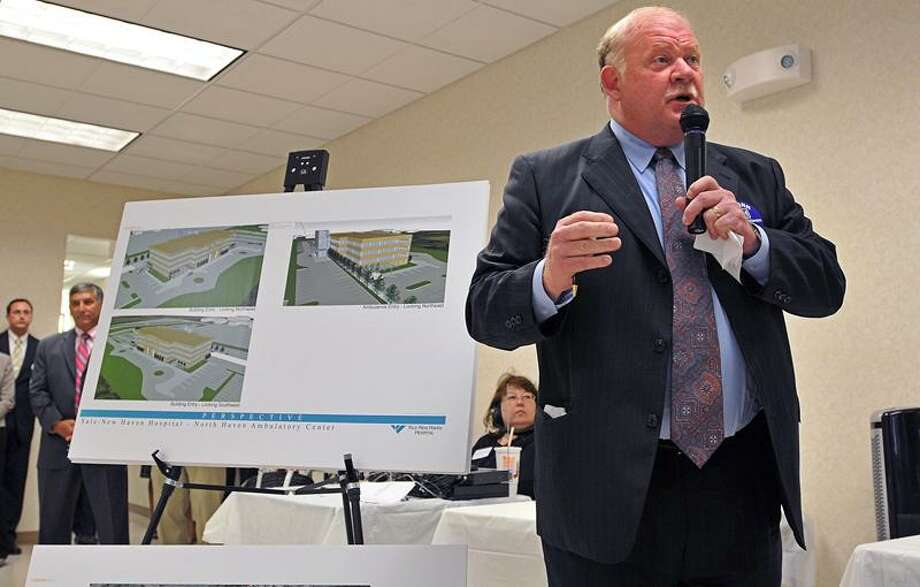 North Haven-- Norman Roth, Senior Vice President of Yale New Haven Hospital explains the proposed North Haven ambulatory center/emergency department to seniors at the Joyce C. Budrow Senior Center during a public hearing. Peter Casolino/Register