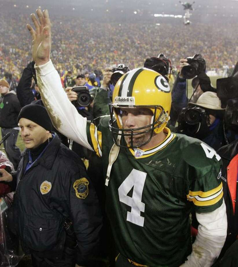 Brett Favre waves to spectators as he leaves the field following the Packers' 9-7 victory over the Minnesota Vikings during an NFL football game in Green Bay, Wis., in this Dec. 21, 2006 file photo. Brett Favre has decided to retire from the NFL after 17 seasons. FOX Sports first reported Tuesday March 4, 2008 that the Green Bay Packers quarterback informed the team in the last few days. (AP Photo/Mike Roemer, file)
