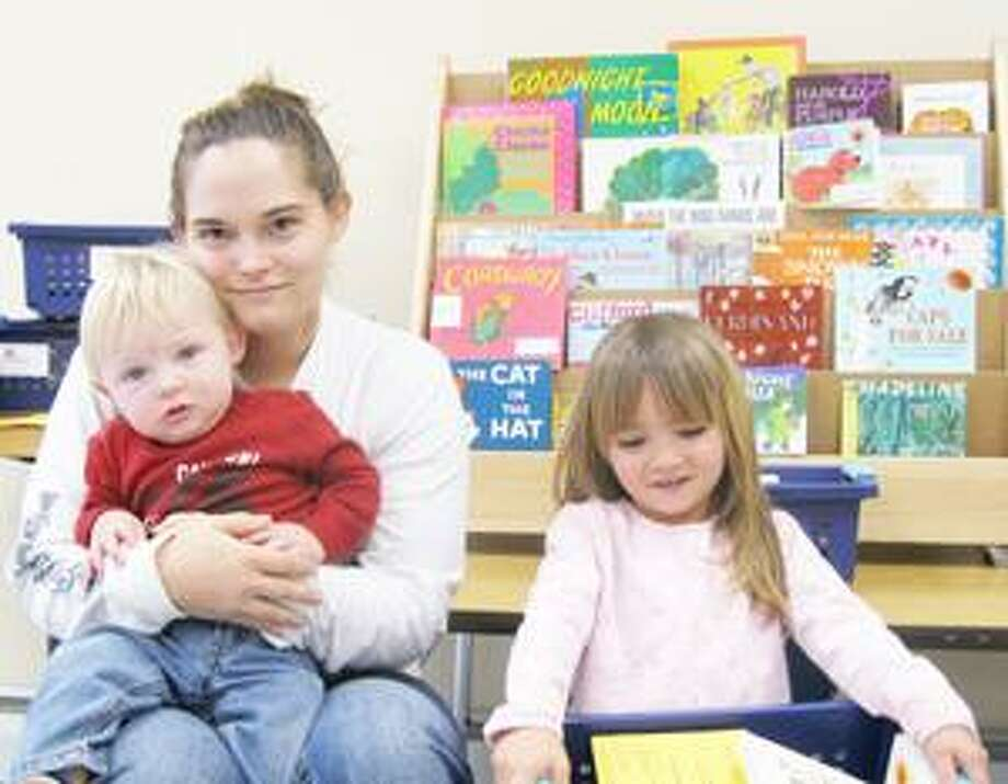 SUBMITTED PHOTO Read Ahead student Amanda Moot with her two children Sheldon and Autumn Rose. Moot earned her GED last May through the Hamilton Public Library's Read Ahead program.