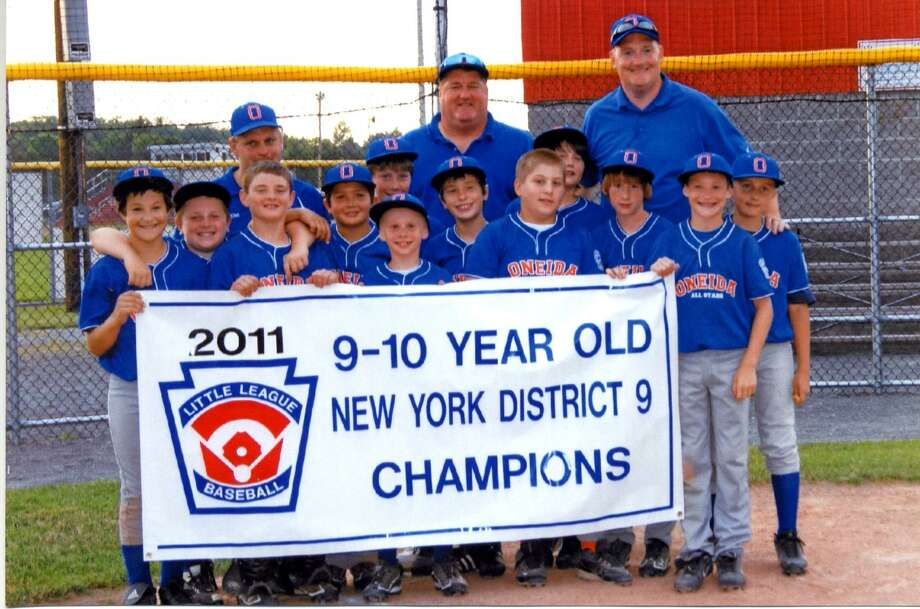 """Submitted Photo The Oneida Little League 9-10 """"Small Stars"""" won the District 9 Championship on July 8 at DeLutis Field. The win advances the team to the Section 2 tournament at Painted Post starting July 14. The team is, from left (front): Jayson Isabelle, Justin Holmes, Vinny Leibl, Jorden Barlow, Steven Valesky, Luke Albro, Josh Goode, Ryan Chevier, Austin Keller, Steven Dibble, Dan Myatt, Zack LaQuay, (back) coach Steve Albro, coach Shane Garbny and coach Brian Myatt."""