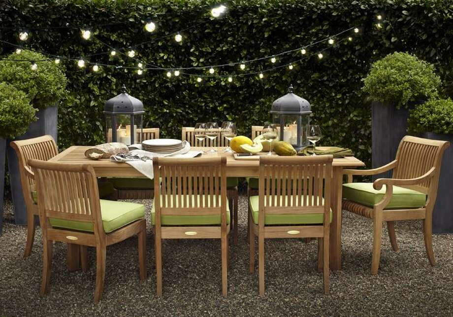 This product image courtesy of Target shows the Smith & Hawken Avignon Teak Extending table and chairs set. You don't have to deal with the mess of tiki torches to create a warm ambiance. Instead, frame your best outdoor views with string lights or paper lanterns that can range from whimsical to contemporary to sophisticated. Photo: AP / AP2010