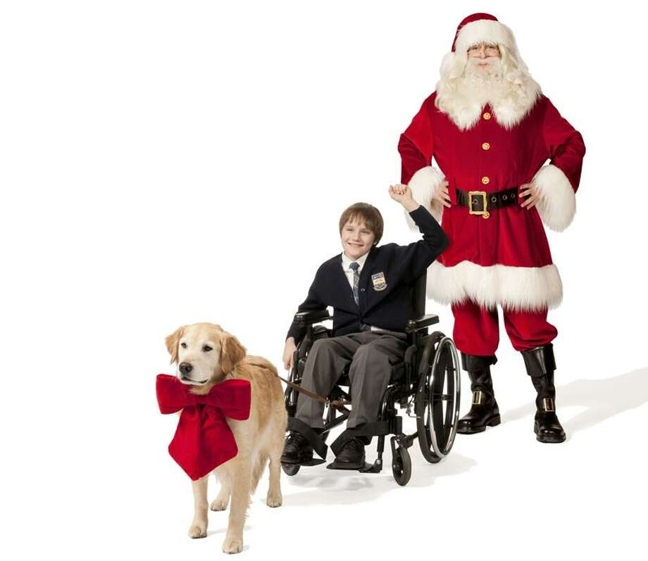 "Hallmark Channel: Christmas miracles are in the cards for a young boy (John Fleming) who was paralyzed in a car accident when Santa shows up disguised as the new school janitor (Judd Nelson) in ""Cancel Christmas"" Nov. 13. Photo: Hallmark Channel / © 2010 Crown Media United States, LLC"