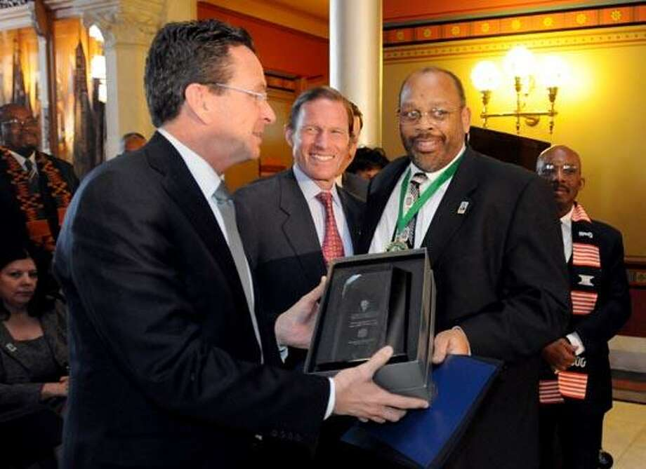 Governor Dannel Malloy, left, with U.S. Senator Richard Blumenthal, second from left,  gives the 2011 Martin Luther King, Jr. Humanitarian Award to Dr Leroy Williams, Principal of the Clemente Leadership School in New Haven, as Leadership Award recipient William Kilpatrick of the New Haven Parking Authority watches, right, during Connecticut's 25th Annual Martin Luther King, Jr. Holiday and National Liberty Bell Ringing Celebration  at the State Capitol in Hartford 1/17/11. Photo by Peter Hvizdak / New Haven RegisterJanuary 17, 2011       ph2239         # 2795   Connecticut