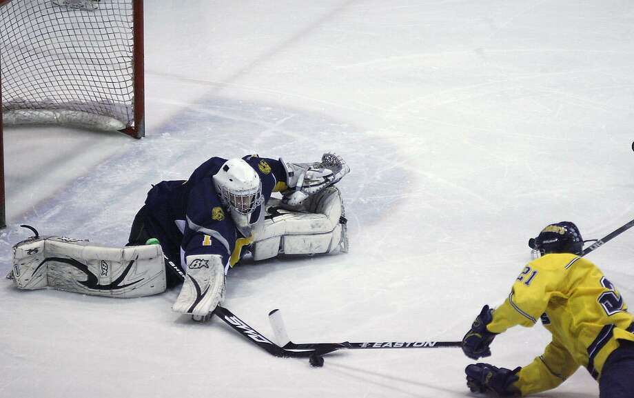 Dispatch Staff Photo by JOHN HAEGER Queensbury goalie Dylan Hafner (1) stops a shot by Cazenovia's Brian Gara (21) in the first period of their NYSPHSAA Division 2 semifinal game in Utica on Saturday, March 12, 2011. Cazenovia won 4-2.