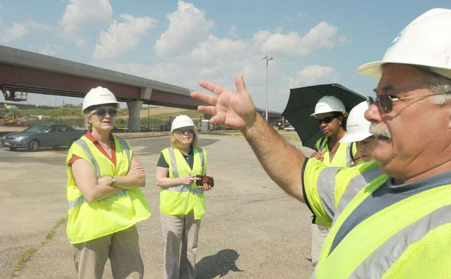 Matt Briggs, Connecticut D.O.T. Project Engineer, far  right, conducts a tour Tuesday 7/12/11  of the Q-Bridge and I-95, I-95 Interchange projects  in New Haven for New Haven Port Authority Commission members Katherine Goodbody, left, Judi Sheiffele, second from left, and Patricia Drax, third from left. New Haven Register reporter Mary O'Leary is second from right.  July 12, 2011       ph2323               # 9118    Connecticut