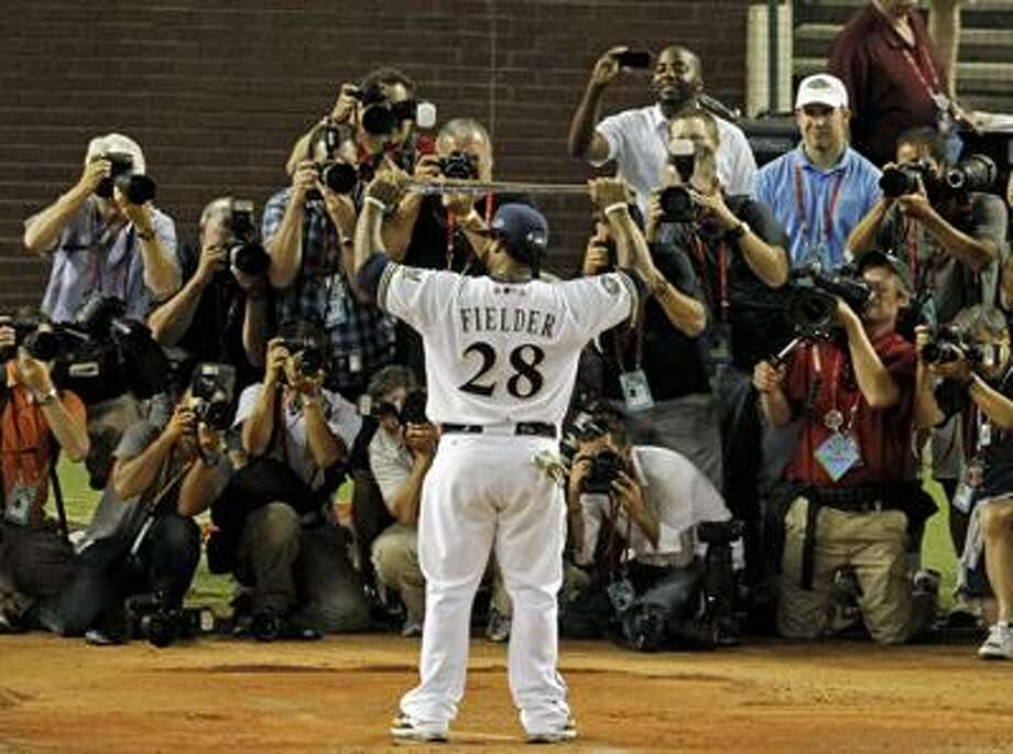 National League's Prince Fielder of the Milwaukee Brewers holds his MVP award following the MLB All-Star baseball game Tuesday, July 12, 2011, in Phoenix. The National League won 5-1. (AP Photo/Ross D. Franklin) Photo: AP / AP