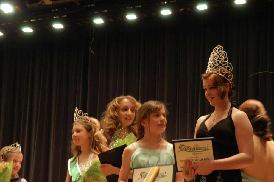 Photo by Caitlin Traynor Chittenango High School Junior Lynea D'Aprix is crowned Miss Oz-Stravaganza Saturday. She will serve as an ambassador during Oz-Stravaganza weekend and ride with the parade's grand marshall.