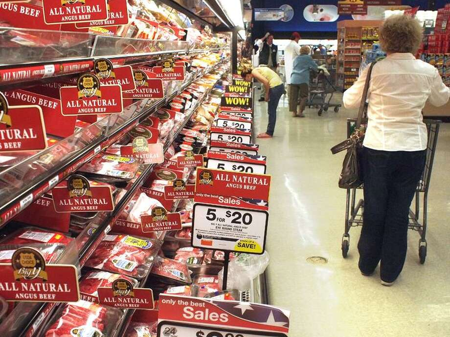 Shoppers peruse the meat aisle at the Big Y in Branhaven Shopping center in Branford. Meat and dairy items, along with gas, were the big contributors to inflation last month. (VM Williams/Register photo)