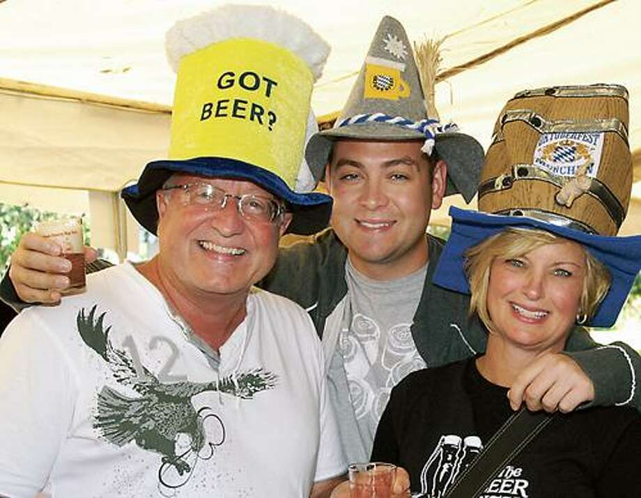 Photo Courtesy MADISON COUNTY HISTORICAL SOCIETY Jim and Debbie Clarey with son James, center, of Oneida, wearing homemade hop hats.