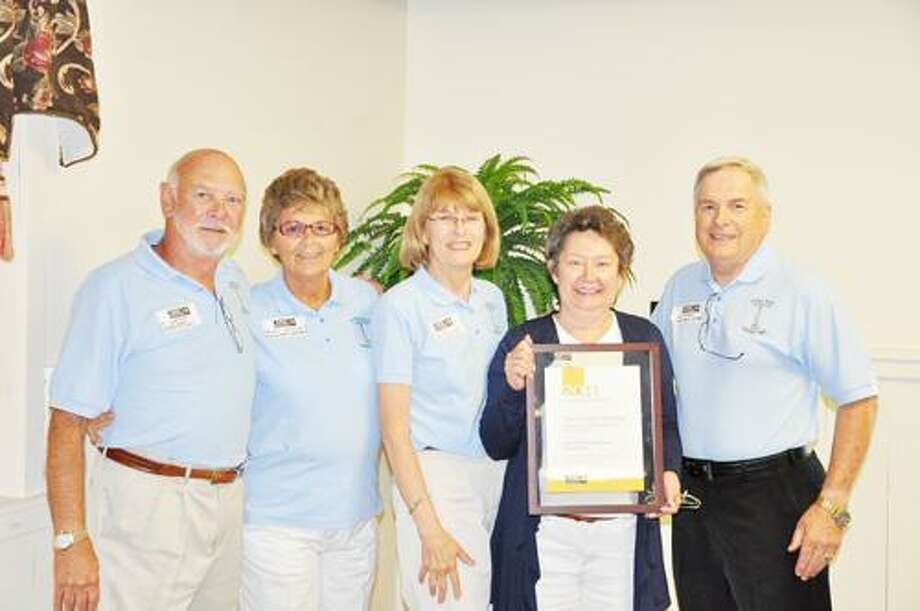 SUBMITTED PHOTO From left are Lee Webster, executive vice president; Dawn Webster, member; Sis Merrill, director; Mary Ann Bigsby, member; and Dave Bigsby, vice president.